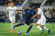 San Jose Earthquakes forward Danny Hoesen (9) battles with LAFC defender Eddie Segura (4) during an MLS soccer match. The LAFC defeated the San Jose Earthquakes 4 - 0 on Wednesday, Aug. 21, 2019, in Los Angeles. (Ed Ruvalcaba/Image of Sport)