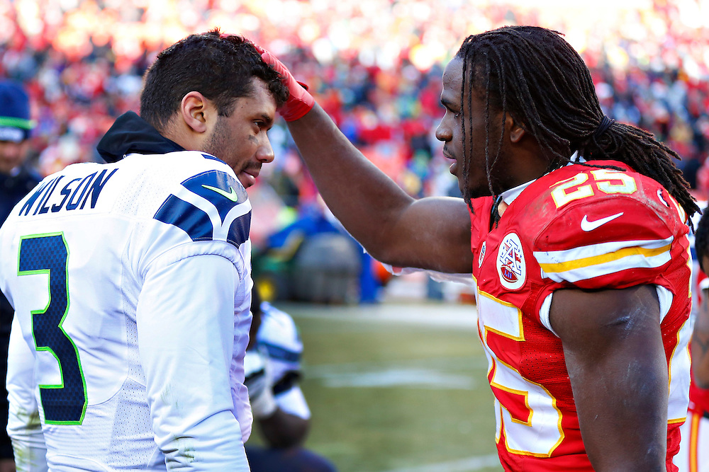 KANSAS CITY, MO - NOVEMBER 16:  Russell Wilson #3 of the Seattle Seahawks is patted on the head by Jamaal Charles #25 of the Kansas City Chiefs after the game at Arrowhead Stadium on November 16, 2014 in Kansas City, Missouri.  The Chiefs defeated the Seahawks 24-20.  (Photo by Wesley Hitt/Getty Images) *** Local Caption *** Russell Wilson; Jamaal Charles
