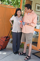 Couple with luggage on vacation