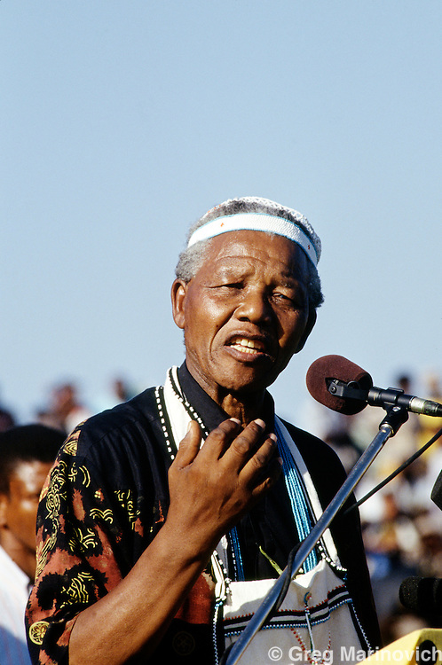 Nelson Mandela, South Africa, 1994. Nelson Mandela addresses a crowd in the former Transkei dressed in traditional Xhosa beads. 1994.