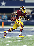 Washington Redskins wide receiver Josh Morgan (15) returns a kick during the NFL week 6 football game against the Dallas Cowboys on Sunday, Oct. 13, 2013 in Arlington, Texas. The Cowboys won the game 31-16. ©Paul Anthony Spinelli