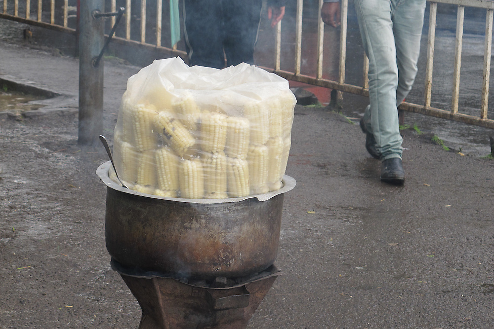 Street vendors steam corn under plastic on a brazier in Addis Ababa district near the University