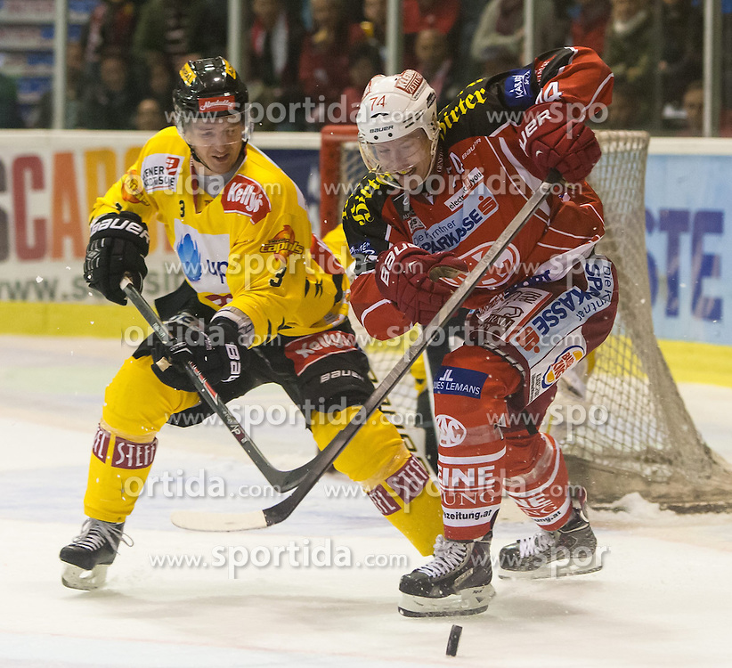 27.10.2013, Stadthalle, Klagenfurt, AUT, EBEL, EC KAC vs Vienna Capitals, 29. Runde, im Bild Justin Fletcher (UPC Vienna Capitals, #3), Jamie Lundmark (Kac, #74) // during the Erste Bank Icehockey League 29th Round match betweeen EC KAC and Vienna Capitals at the City Hall, Klagenfurt, Austria on 2013/10/27. EXPA Pictures © 2013, PhotoCredit: EXPA/ Gert Steinthaler