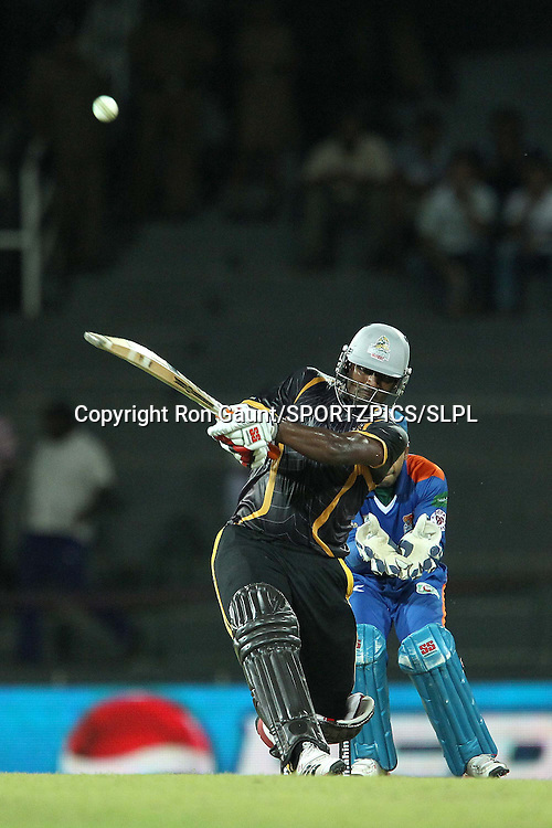 Thisara Perera knocks a six to reach his half century during match 5 of the Sri Lankan Premier League between Kandurata Warriors and Nagenahira Nagas held at the Premadasa Stadium in Colombo, Sri Lanka on the 13th August 2012<br />  <br /> Photo by Ron Gaunt/SPORTZPICS/SLPL