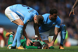 9th September 2017 - Premier League - Manchester City v Liverpool - John Stones of Man City (L) and teammate Kyle Walker tend to their injured goalkeeper Ederson - Photo: Simon Stacpoole / Offside.