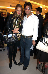 JAG BOLINA and REBECCA VON MEISTER at the launch of Roberto Cavalli Vodka held in the International Designer Room, Harrods, Hans Crescent, London on 5th December 2006.<br />