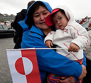 Greenlandic woman and child outside the Cathedral Annaassisitta Oqaluffia, Nuuk, on National Day, celebrating Self Governanc.  From June 21 2009, Greenland moves from being under 'home rule' to 'self-governance' in a ceremony attended by the Danish Royal family and other heads of state.