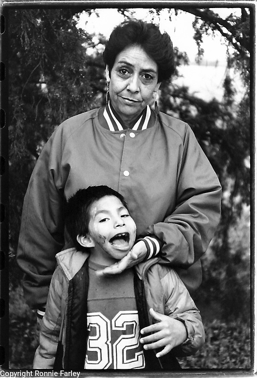 Roberta Whitecalf, descendent of Red Cloud, with her adopted son Rocky, who is a fetal-alcohol syndrome child, Pine Ridge Reservation, Manderson, South Dakota, 1992