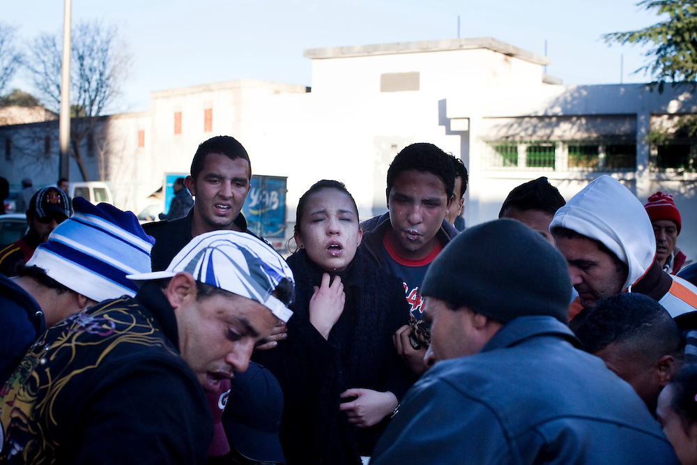 Tunis, Tunisia. January 28th 2011.A woman is about to collapse because the Police tear gas....