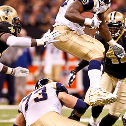 December 12, 2010; New Orleans, LA, USA; St. Louis Rams running back Steven Jackson (39) jumps over a teammate on a run against the New Orleans Saints during the second half at the Louisiana Superdome. Mandatory Credit: Derick E. Hingle-US PRESSWIRE