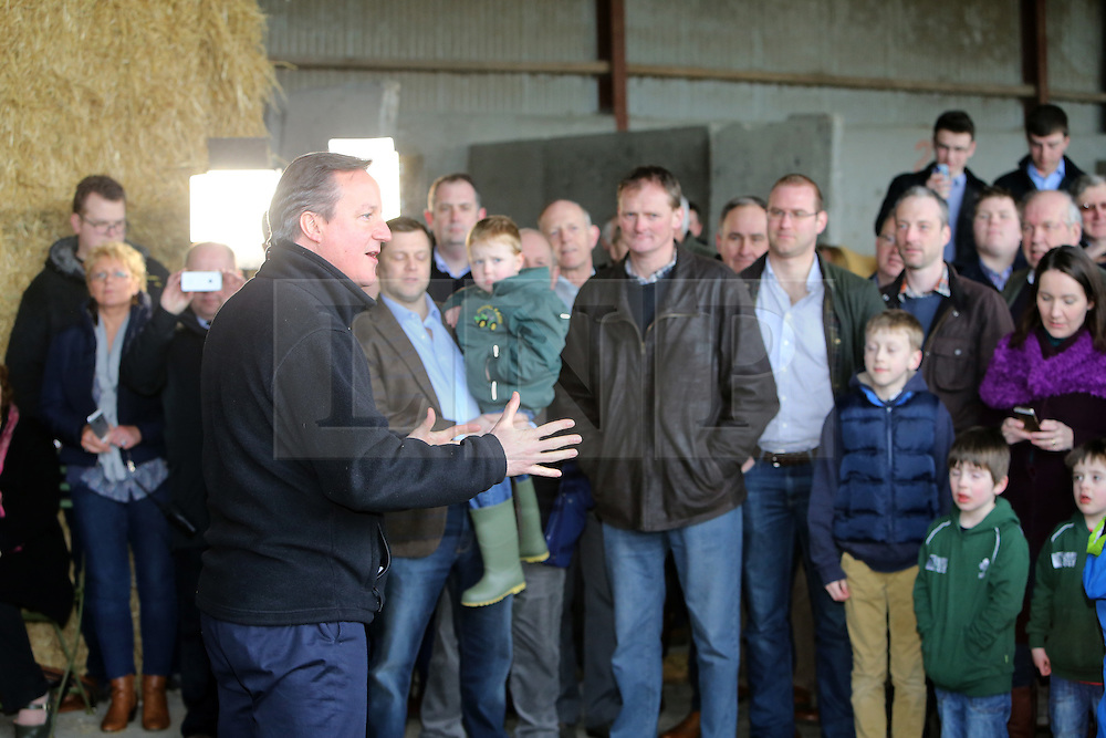 Licensed to London News Pictures. 27/02/2016. Ahoghill, County Antrim, Northern Ireland, UK. Prime Minister David Cameron speaks to farmers during a tour of Harry Johnston dairy farm in Ahoghill, County Antrim. Prime Minister David Cameron was on a tour to persuade voters that membership of a reformed EU is in their best interests. Photo credit : Paul McErlane/LNP