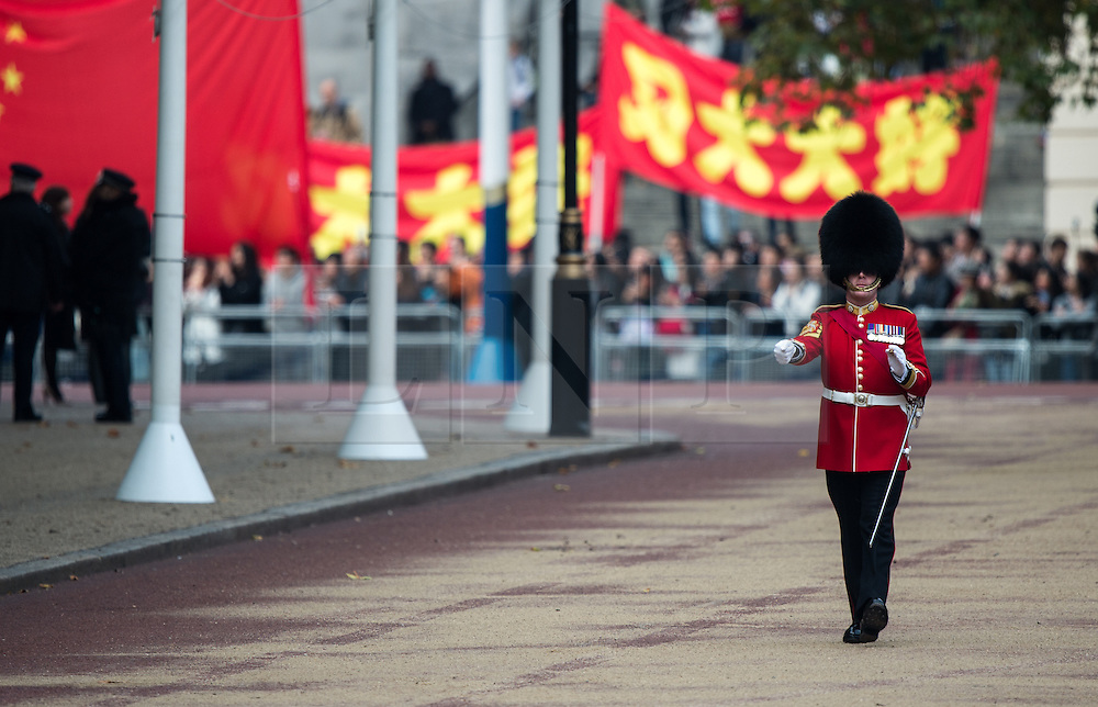 © London News Pictures 20/10/2015. Garrison Sergeant Major WO1 Vern Stokes oversees the Troops on parade.<br /> <br /> More than 1,100 soldiers and 230 horses joined HM The Queen, HRH The Duke of Edinburgh, The Duke and Duchess of Cornwall, the Prime Minister, Senior members of the Cabinet, the Lord Mayor of London, the Mayor of London, and the Defence Chiefs of Staff for the ceremonial welcome to Britain of The President of The People's Republic of China and Madame Peng Liyuan . Photo credit: Rupert Frere/LNP