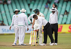 Durban. 010218. Players and umpires leaves the field after bad light stopped play during the first Sunfoil Test Match played at Kingsmead in Durban. Picture Leon Lestrade/African News Agency/ANA