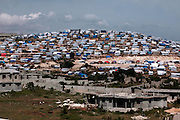 July 2010 - Massive tent cities are located above neighborhoods still under construction in an area just outside of Port-au-Prince, Haiti. More than million people were displaced from the magnitude-7.0 earthquake that struck Haiti in January 2010.