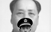 21 March 2006 - Beijing, China - A People's Liberation Army soldier stands guard in front of the portrait of Mao Zedong in Tiananmen Square. Photo by Natalie Behring