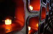 A line of votive candles burns near the entrace to St. John's Abbey in St. Cloud, Minnesota.