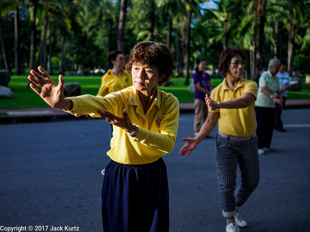 05 JUNE 2017 - BANGKOK, THAILAND: A tai-chi class for adults in Lumpini Park in Bangkok. Thai health officials estimate that about 17% of Thais are 60 years old and older, putting Thailand right on the cusp of being an aging society. Many public health centers and government offices in Thailand offer free exercise classes for Thai seniors in an effort to keep older Thais healthy and mobile.      PHOTO BY JACK KURTZ