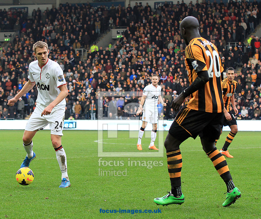 Picture by Richard Gould/Focus Images Ltd +44 7855 403186<br /> 26/12/2013<br /> Yannick Sagbo (left) of Hull City faces Darren Fletcher of Manchester United during the Barclays Premier League match at the KC Stadium, Kingston upon Hull.