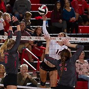 09 November 2017:  The San Diego State Aztecs women's volleyball team hosts UNLV Thursday night at Peterson Gym. San Diego State middle blocker Baylee Little (16) spikes the ball in-between two UNLV defenders. The Aztecs won 3-1 (25-18; 16-25; 25-12; 25-13).<br /> www.sdsuaztecphotos.com