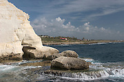 The white cliff at Rosh Hanikra, Israel. Rosh Hanikra is a chalk cliff on the beach of Upper-Galilee on the border between Israel and Lebanon, chiselled out into labyrinthine grottoes filled with seawater formed by the geological and biological processes and by waves lapping on the soft rock.