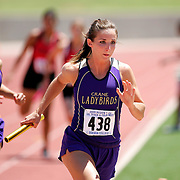 Summer Sutherland, the second leg of the Crane High School girls 4X200m relay team, completes first hand off with teammate Beatris Salcedo Wednesday afternoon at the Region I-2A track and field meet at Ratliff Stadium in Odessa..photo by Gary Rhodes 05/20/09