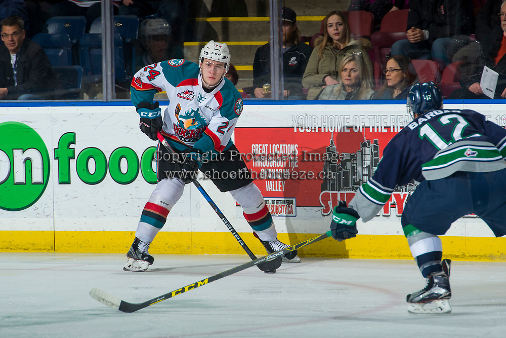KELOWNA, CANADA - JANUARY 5: Blake Bargar #12 of the Seattle Thunderbirds stick checks Kyle Topping #24 of the Kelowna Rockets on January 5, 2017 at Prospera Place in Kelowna, British Columbia, Canada.  (Photo by Marissa Baecker/Shoot the Breeze)  *** Local Caption ***