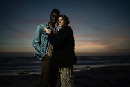 Two models pose on the beach in Monterey, CA May 10, 2018.   Photo by Ken Cedeno