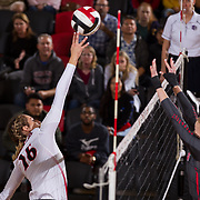 09 November 2017:  The San Diego State Aztecs women's volleyball team hosts UNLV Thursday night at Peterson Gym. San Diego State middle blocker Baylee Little (16) taps the ball over two UNLV defenders. The Aztecs won 3-1 (25-18; 16-25; 25-12; 25-13).<br /> www.sdsuaztecphotos.com