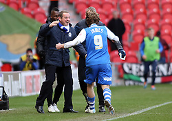Peterborough United Manager, Dave Robertson congratulates goalscorer Luke James - Photo mandatory by-line: Joe Dent/JMP - Mobile: 07966 386802 - 14/03/2015 - SPORT - Football - Doncaster - Keepmoat Stadium - Doncaster Rovers v Peterborough United - Sky Bet League One