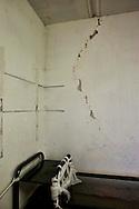 Roma 7 Febbraio  2014<br /> Il Centro di identificazione ed espulsione (CIE), per immigrati di Ponte Galeria a Roma.L'interno di una stanza con il muro rotto<br />   Center for Identification and Expulsion (CIE) for immigrants from Ponte Galeria in Rome. The interior of a room with a  broken wall
