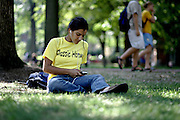 Freshman Math major Aupala Huq finds a new song on her IPOD on the Campus Green on Monday September 12, 2005.