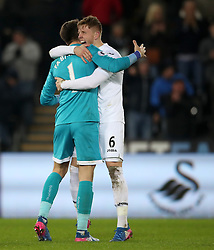 Swansea City goalkeeper Lukasz Fabianski (left) and Alfie Mawson after the Premier League match at the Liberty Stadium, Swansea.