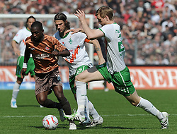 23.04.2011, Millerntor Stadion, Hamburg, GER, 1.FBL, FC St. Pauli vs Werder Bremen, im Bild Charles Takyi (St. Pauli #10), Torsten Frings (Bremen #22, hinten), Per Mertesacker (Bremen #29)   EXPA Pictures © 2011, PhotoCredit: EXPA/ nph/  Frisch       ****** out of GER / SWE / CRO  / BEL ******