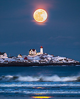 As one of the premier photographic destination in New England, and even the world, Nubble Lighthouse is a tough place to get an 'original' image. Last year, Michael Blanchette captured a stunning view of this lighthouse during a full moon that left us awestruck. Some could be discouraged following in the footsteps of brilliance, but I was personally inspired. It made me want to get down here and make a powerful moon image myself. The opportunity presented itself yesterday evening, with a full moon and predictions of clear skies. Since I've had use of a 400mm lens, it's been fun to getting the moon to appear larger by compressing scenes that are far away. Using the photographer's ephemeris, I saw that the moon would rise over Nubble from about 20 degrees southwest on Long Sands Beach. My photography buddy Adam Woodworth joined me, and we climbed through waist-high snow drifts to get into position.This wasn't the image I had in mind. A bank of clouds obscured the horizon and blocked what I was hoping would be a moonrise directly behind the lighthouse itself, creating an extremely dramatic silhouette. What we got instead was perhaps even more beautiful, and definitely more believable. The moon broke through the clouds just above Cape Neddick, right where the ephemeris said it would, and Adam and I went to town trying to keep up with it's rapid movement across the sky. We would stop, make a few frames, then pick up the camera and jog a few yards to the left every minute or so until we had gone about 30 yards from our original location, all in that waist-deep snow. Haha! What a blast!