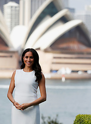 File photo dated 16/10/18 of The Duchess of Sussex standing in the grounds of Admiralty House in Sydney, with a view of the Sydney Opera House, on the first day of the royal couple's visit to Australia. The Duchess of Sussex is counting down the days to the arrival of her first child.