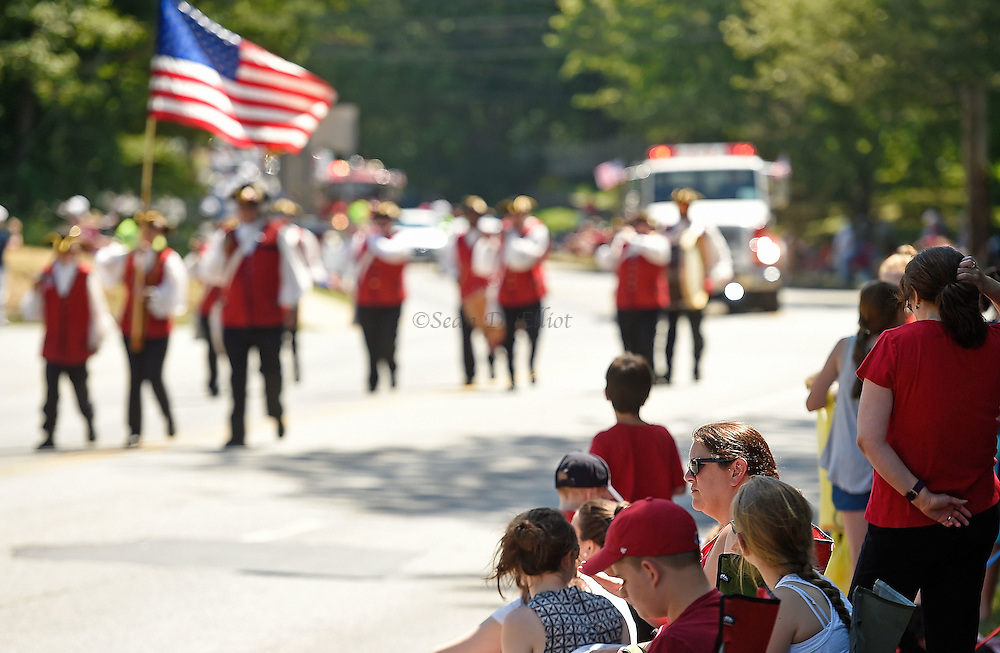7/4/16 :: REGION :: SMITH :: Paradegoers watch as the Deep River Drum Corps marches by in the Groton Independence Day Parade Monday, July 4, 2016. (Sean D. Elliot/The Day)