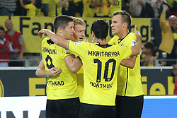 "23.08.2013, Signal Iduna Park, Dortmund, GER, 1. FBL, Borussia Dortmund vs SV Werder Bremen, 3. Runde, im Bild Marco Reus #11 (Borussia Dortmund), Henrikh ""Micki"" Mkhihtaryan #10 (Borussia Dortmund) und Kevin Grosskreutz #19 (Borussia Dortmund) gratulieren dem Torschuetzen Robert Lewandowski #9 (Borussia Dortmund) // during the German Bundesliga 3rd round match between Borussia Dortmund and SV Werder Bremen at the Signal Iduna Park, Dortmund, Germany on 2013/08/23. EXPA Pictures � 2013, PhotoCredit: EXPA/ Eibner/ Joerg Schueler<br /> <br /> ***** ATTENTION - OUT OF GER *****"
