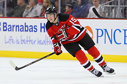 Dec 18, 2013; Newark, NJ, USA;  New Jersey Devils center Reid Boucher (15) skates during the first period of their game against the Ottawa Senators at the Prudential Center. Boucher scored his first NHL goal.