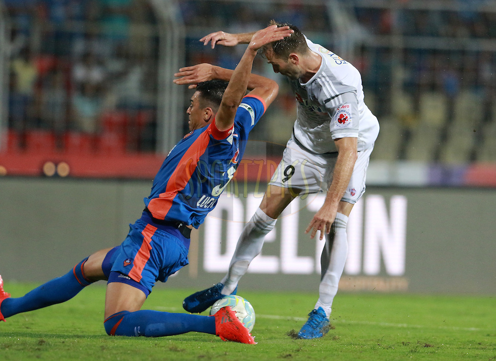 Lucio of FC Goa and Anibal Zurdo&Ecirc;Rodr&rsquo;guez of FC Pune City in action during match 8 of the Indian Super League (ISL) season 3 between FC Goa and FC Pune City held at the Fatorda Stadium in Goa, India on the 8th October 2016.<br /> <br /> Photo by Vipin Pawar / ISL/ SPORTZPICS