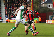 Picture by Tom Smith/Focus Images Ltd 07545141164<br /> 26/12/2013<br /> Ryan Fraser (right) of Bournemouth is tackled by John Lundstorm (left) of Yeovil Town during the Sky Bet Championship match at the Goldsands Stadium, Bournemouth.