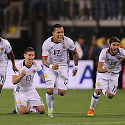 EAST RUTHERFORD, NEW JERSEY - JUNE 17: Colombia players react to Peru's final penalty miss to win the penalty shoot out players, from left, Juan Cuadrado #11, James Rodriguez #10, Dayro Moreno #17 and Sebastian Perez #13 of Colombia during the Colombia Vs Peru Quarterfinal match of the Copa America Centenario USA 2016 Tournament at MetLife Stadium on June 17, 2016 in East Rutherford, New Jersey. (Photo by Tim Clayton/Corbis via Getty Images)