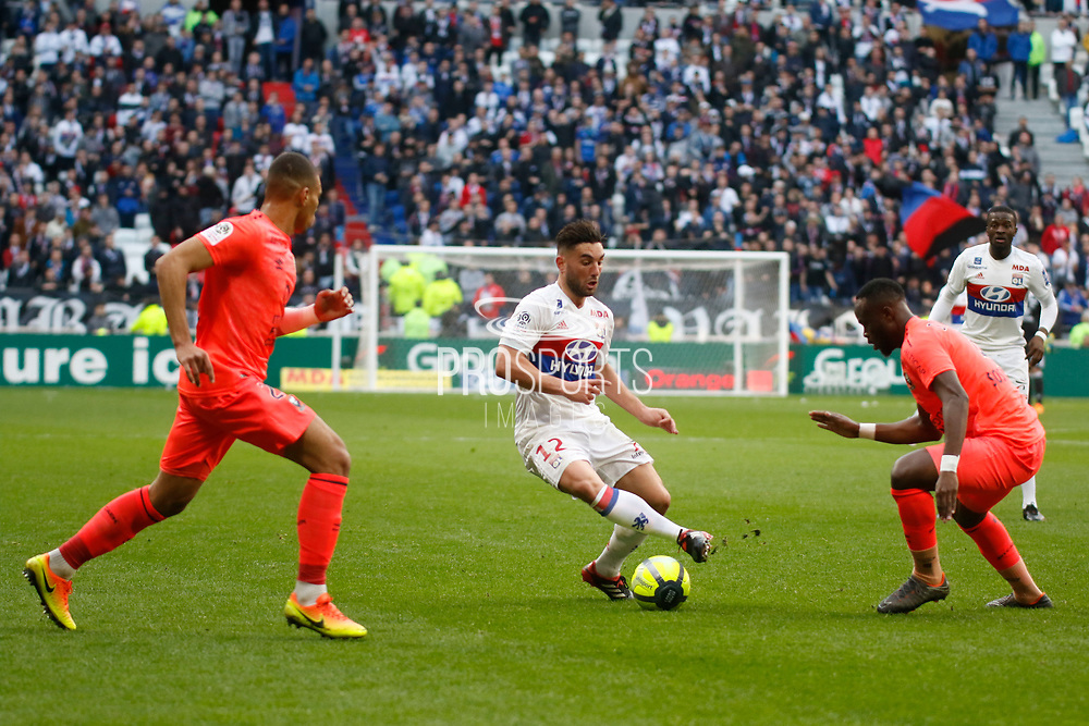 Jordan Ferri of Lyon and Tiémoko Diomande of Caen and Alexander Djiku of Caen during the French Championship Ligue 1 football match between Olympique Lyonnais and SM Caen on march 11, 2018 at Groupama stadium in Decines-Charpieu near Lyon, France - Photo Romain Biard / Isports / ProSportsImages / DPPI