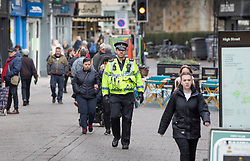 © Licensed to London News Pictures. 04/03/2019. Salisbury, UK. A police officer walks along Salisbury High Street on the first anniversary of the poisoning of former Russian spy Sergei Skripal and his daughter Yulia in March 2018. They both survived the nerve agent attack but a resident of nearby Amesbury, Dawn Sturgess, died in June 2018 after coming in contact with the poison. Two Russians have been named in connection with the attack. Photo credit: Peter Macdiarmid/LNP