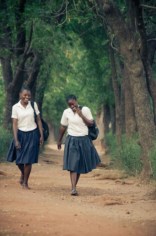 Two girls making their way back from their dormitory along the tranquil school grounds.