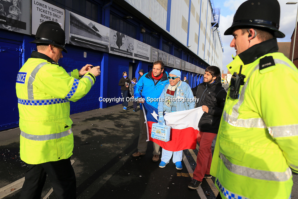 10th January 2015 - Barclays Premier League - Everton v Manchester City - A policeman takes a photograph of Man City fans - Photo: Simon Stacpoole / Offside.