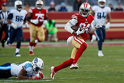 SANTA CLARA, CA - DECEMBER 17: Wide receiver Kendrick Bourne #84 of the San Francisco 49ers breaks a tackle from free safety Kevin Byard #31 of the Tennessee Titans during the fourth quarter at Levi's Stadium on December 17, 2017 in Santa Clara, California. The San Francisco 49ers defeated the Tennessee Titans 25-23. (Photo by Jason O. Watson/Getty Images) *** Local Caption *** Kendrick Bourne; Kevin Byard