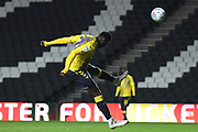 Coventry City striker Amadou Bakayoko (21) heads the ball during the EFL Trophy match between Milton Keynes Dons and Coventry City at Stadium:MK, Milton Keynes, England on 3 December 2019.