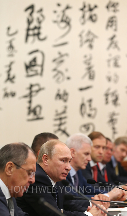 epa04482494 Russian President Vladimir Putin (2-L) speaks to his Chinese counterpart Xi Jinping (not seen) during a bilateral meeting at the Diaoyutai State Guesthouse, on the sidelines of the Asia-Pacific Economic Cooperation (APEC) 2014 Summit, in Beijing, China, 09 November 2014. Others are not identified. The APEC 2014 Summit and related meetings will be held in Beijing from 05 to 11 November, gathering leaders of 21 member economies.  EPA/HOW HWEE YOUNG / POOL