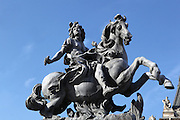 Low angle view of equestrian statue of Louis XIV (1638-1715) in the Cour Napoleon, Louvre,  Paris, France. The statue is a copy in lead, 1988, of original statue at Versailles, by Gian Lorenzo Bernini, (1598-1680). Louis XIV invited Bernini to Paris in 1665 to design a new wing of the Louvre in which he subsequently lost interest, but Bernini did design this sculpture of Louis as a Roman Emperor, resplendent on horseback. It was the idea of the architect of the Grand Louvre, I M Pei to place a copy of the statue in the Cour Napoleon, in the sightline of the Champs Elysees. It was placed there before the pyramid was built. Picture  by Manuel Cohen.