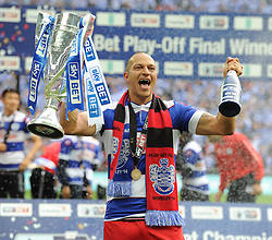 Queen Park Rangers' Bobby Zamora celebrates the win holding the trophy in his hand.  - Photo mandatory by-line: Alex James/JMP - Tel: Mobile: 07966 386802 24/04/2014 - SPORT - FOOTBALL - wembley - London -  Derby County V Queens Park Rangers - Play off final